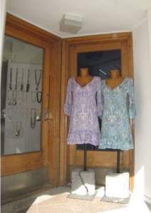 Dresses in the doorway of the shop